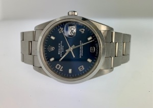 ROLEX DATE 15200 UNISEX WATCH - 34MM - STAINLESS STEEL CASE - STAINLESS STEEL OYSTER BRACELET - BLUE DIAL WITH ALTERNATING SILVER ARABIC & LUMINESCENT HOUR MARKERS / STAINLESS STEEL HOUR & MINUTE HANDS - STAINLESS STEEL SMOOTH FIXED BEZEL - SCRATCH RESIST