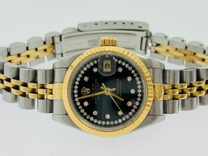 ROLEX DATEJUST 69173 LADIES WATCH - 26 MM - STAINLESS STEEL CASE - STAINLESS STEEL & 18K YELLOW GOLD JUBILEE BRACELET - ORIGINAL BLACK DIAL WITH DIAMOND HOUR MARKERS / STRING DIAMONDS AROUND PERIMETER OF DIAL / YELLOW GOLD HOUR & MINUTE HANDS - 18K YELLOW