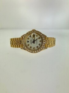ROLEX PRESIDENTIAL DATEJUST 69178 LADIES WATCH - 26 MM - 18K YELLOW GOLD CASE WITH CUSTOM DIAMOND LUGS - 18K YELLOW GOLD PRESIDENTIAL BRACELET CUSTOMIZED WITH DIAMONDS ADDED TO CENTER LINKS OF BRACELET - CUSTOM WHITE DIAL WITH 'CUSHION' SET DIAMOND HOUR M