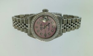 ROLEX DATEJUST 79174 LADIES WATCH - 26 MM - STAINLESS STEEL CASE - STAINLESS STEEL BRACELET WITH DEPLOYMENT CLASP - CUSTOM PINK MOTHER OF PEARL CUSHION SET DIAMOND DIAL / STEEL LUMINESCENT HOUR & MINUTE HANDS / DATE AT 3 O'CLOCK - CUSTOM WHITE GOLD PAVE S